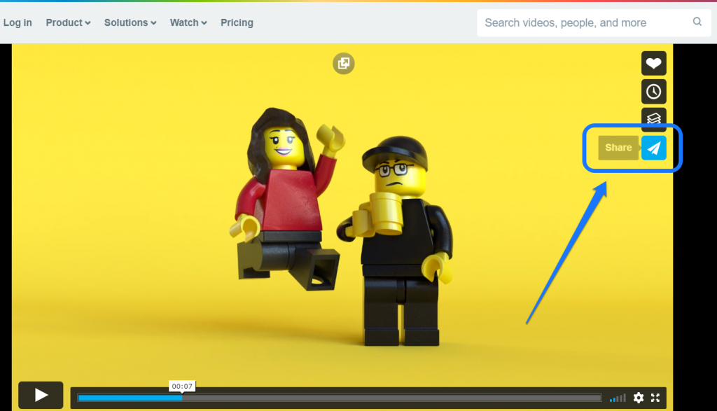 Pointing at the Share icon of a Lego video in Vimeo